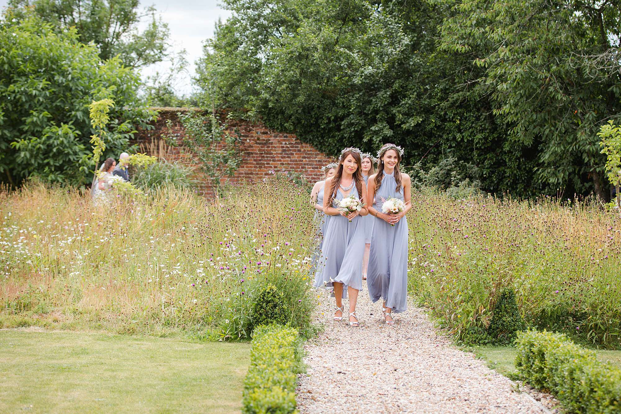 fun outdoor wedding bridesmaids walk down aisle outdoors