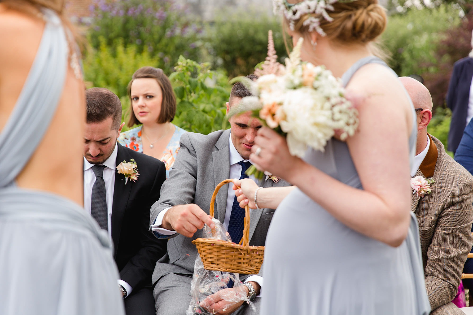 fun outdoor wedding bridesmaids hand out confetti