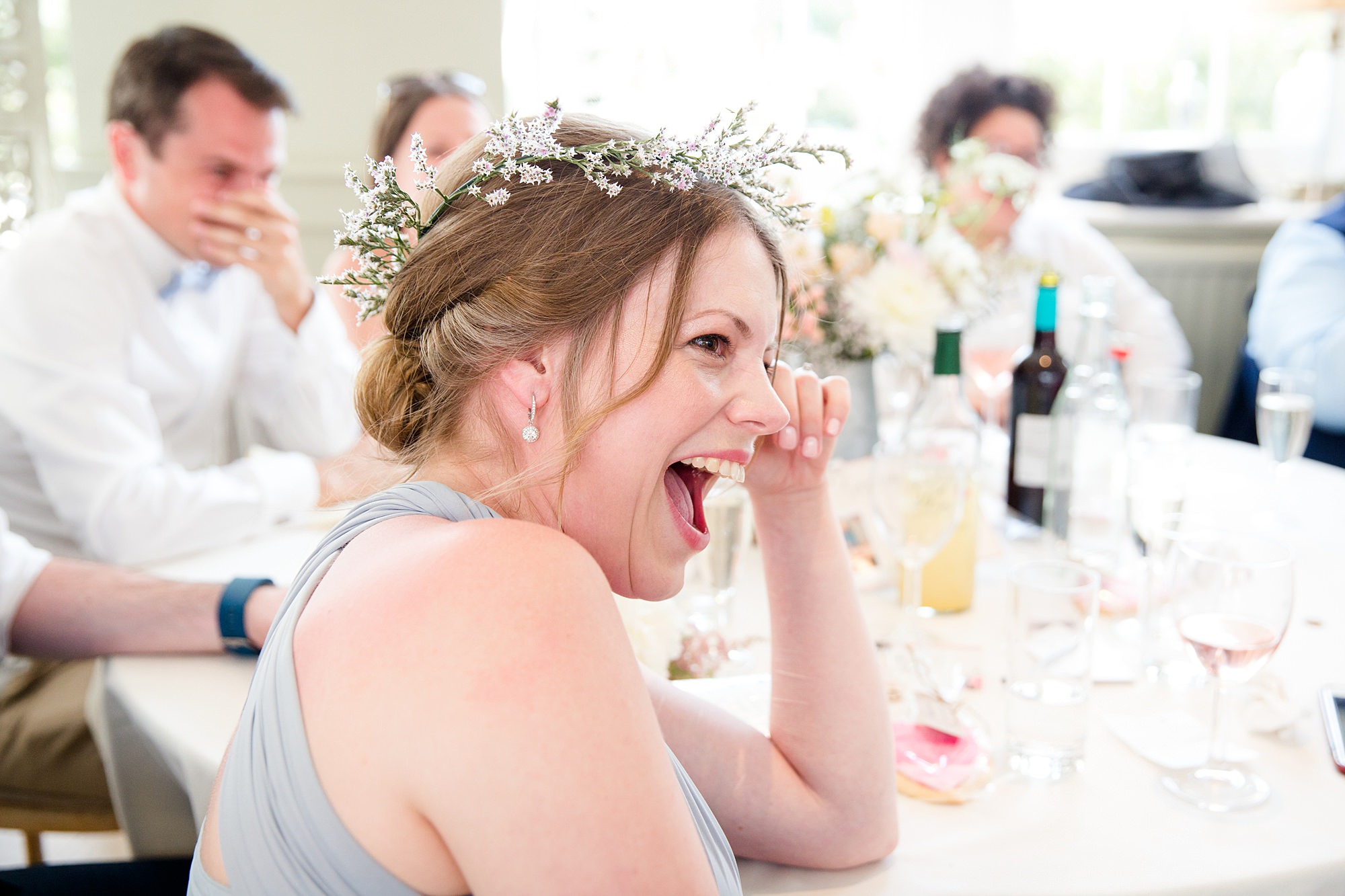 fun outdoor wedding guest laughing at speeches