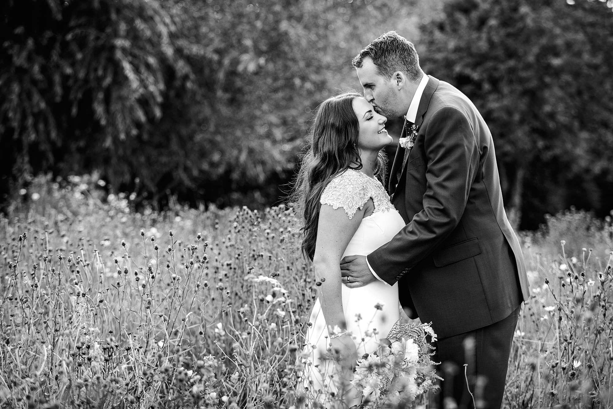 fun outdoor wedding bride and groom in wild garden