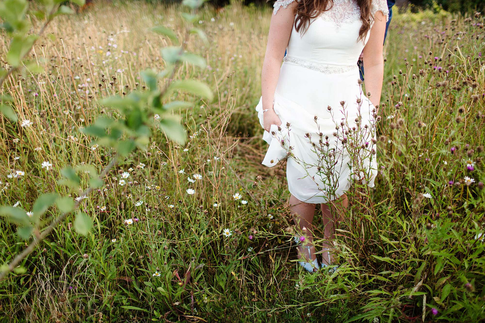fun outdoor wedding bride in wild grasses