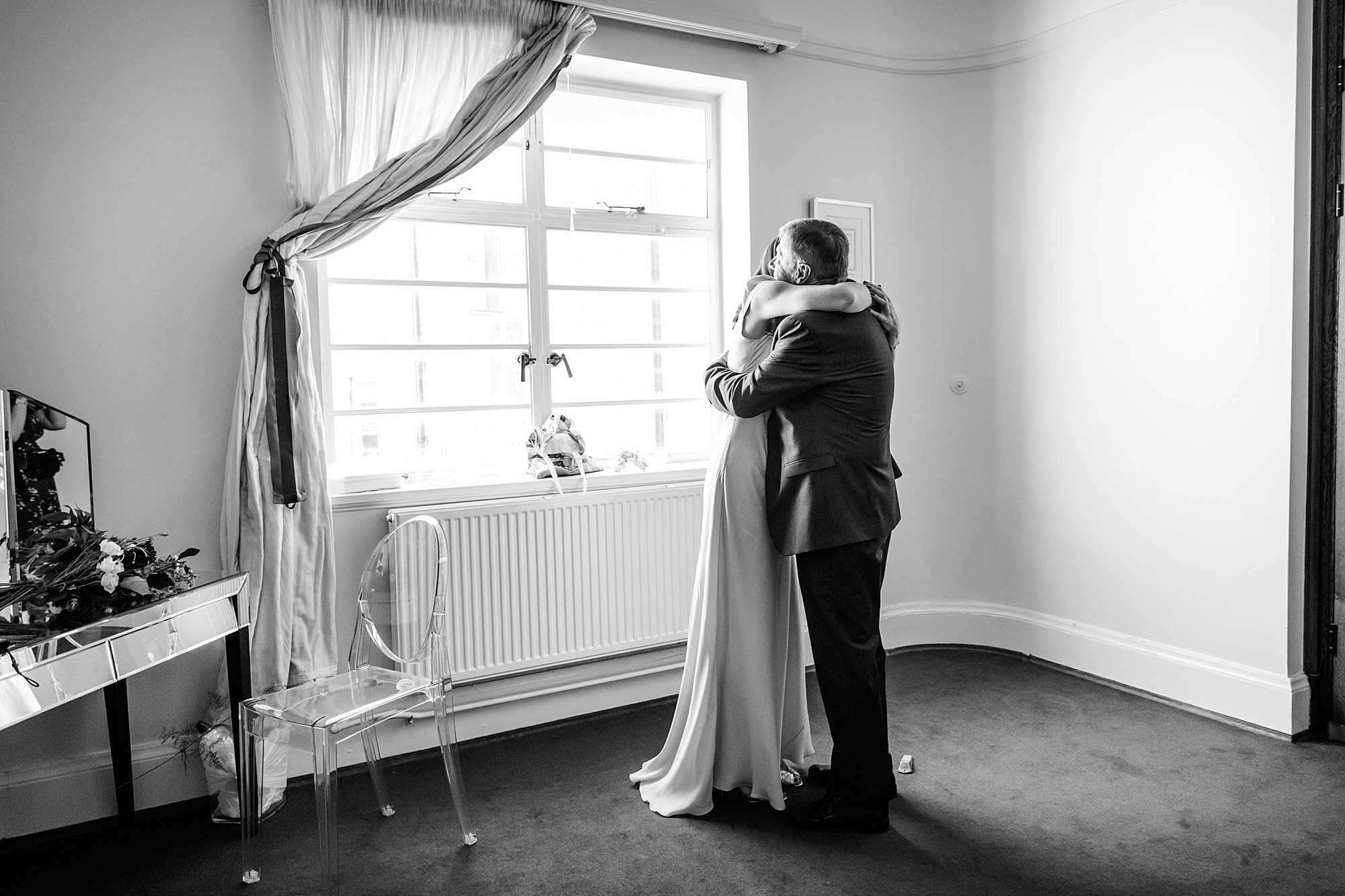 Clapton Country Club wedding photography bride hugs father