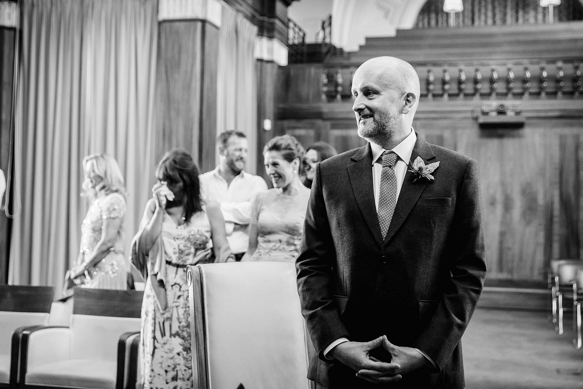 Clapton Country Club wedding photography groom watches bride entrance