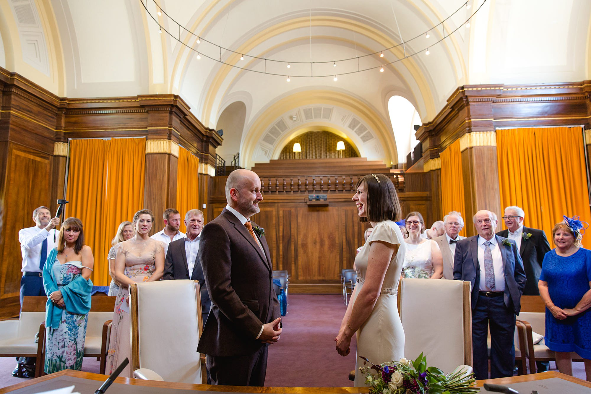Clapton Country Club wedding photography bride and groom exchange vows
