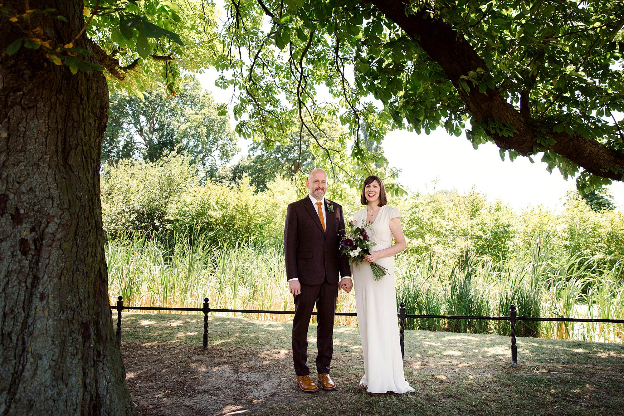 Clapton Country Club wedding photography ceremony bride and groom under a tree