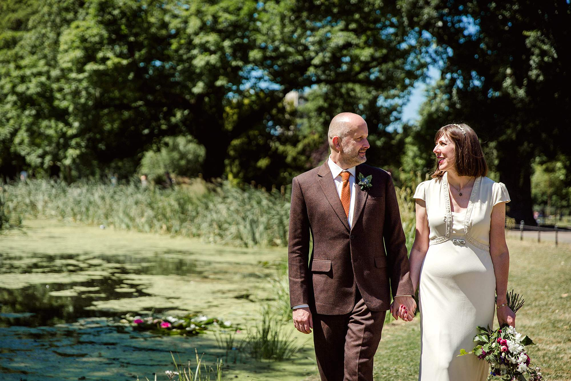 Clapton Country Club wedding photography bride and groom walking