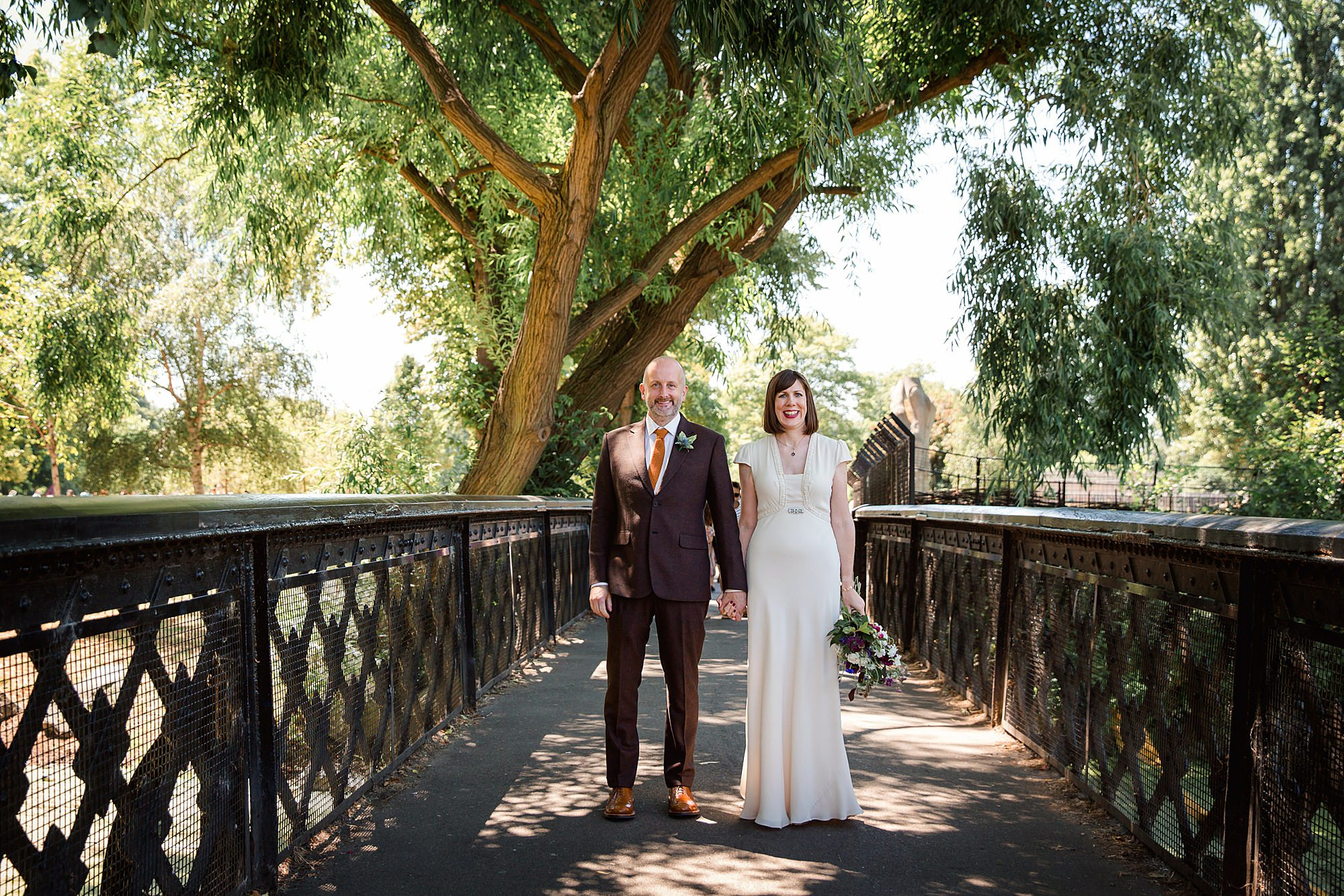 Clapton Country Club wedding photography bride and groom on bridge