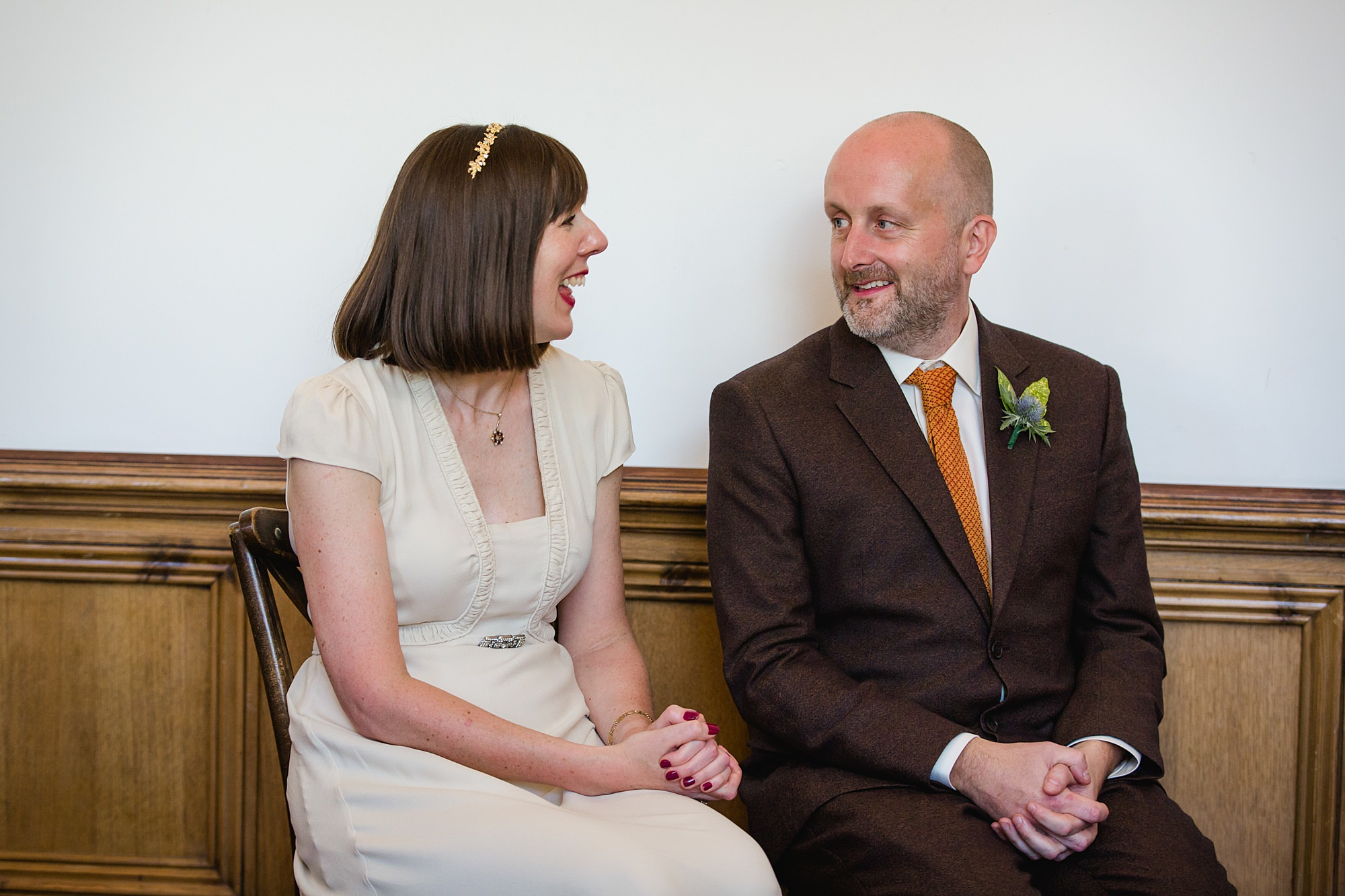 Clapton Country Club wedding photography bride and groom smile during humanist ceremony