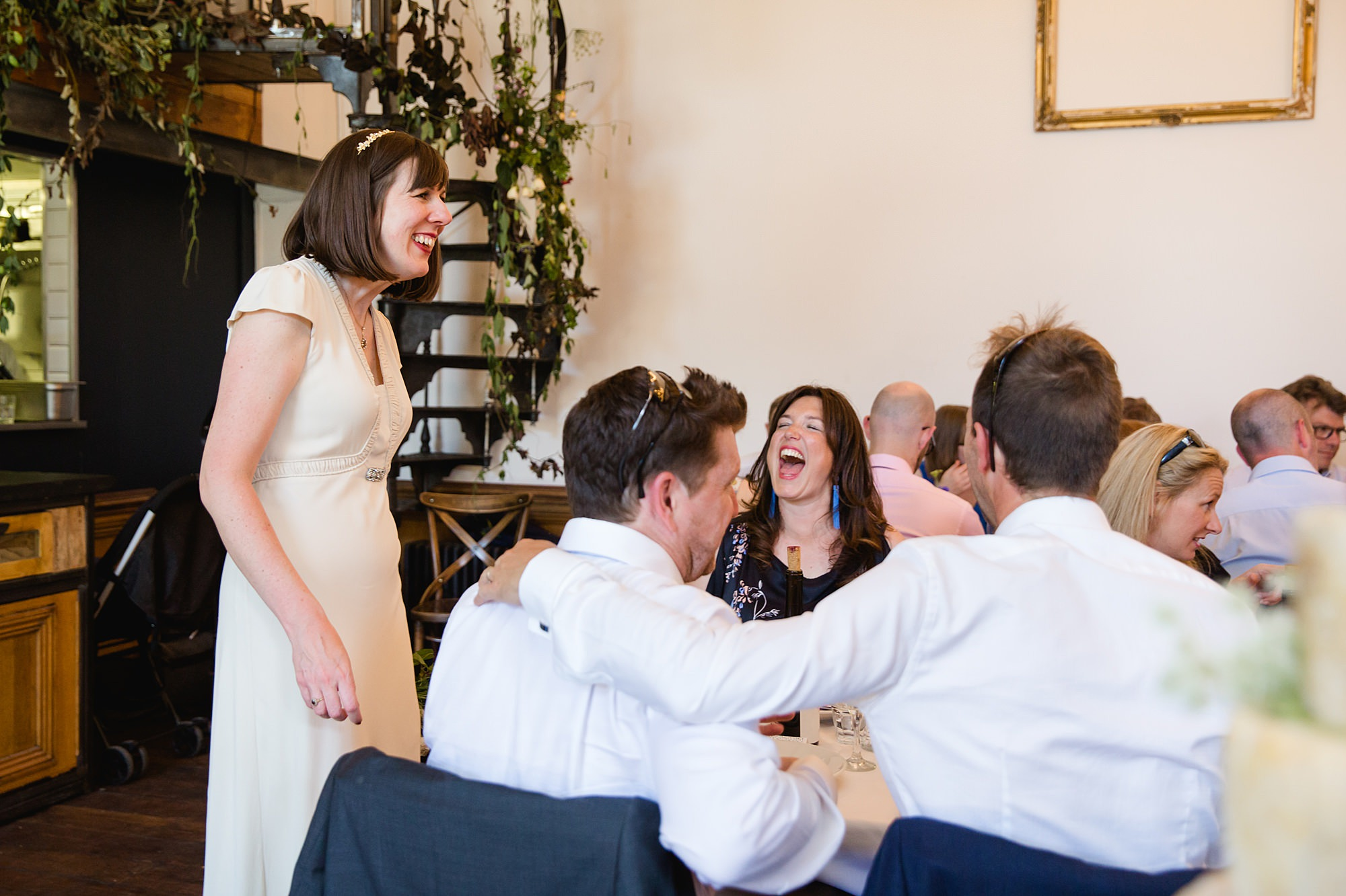 Clapton Country Club wedding photography guests laughing