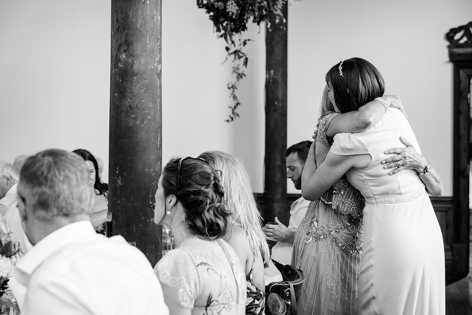 Clapton Country Club wedding photography bride hugs a guest