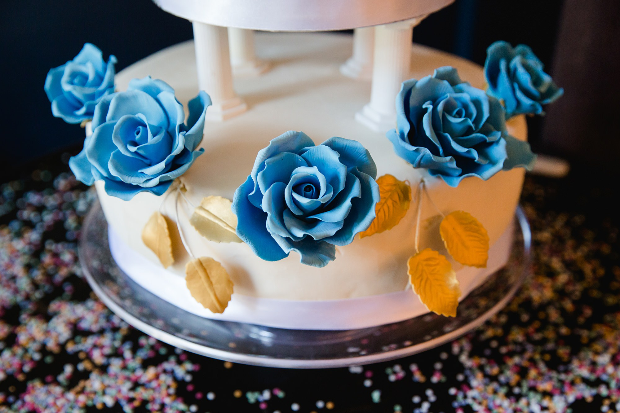 Clapton Country Club wedding photography blue sugar flowers on cake