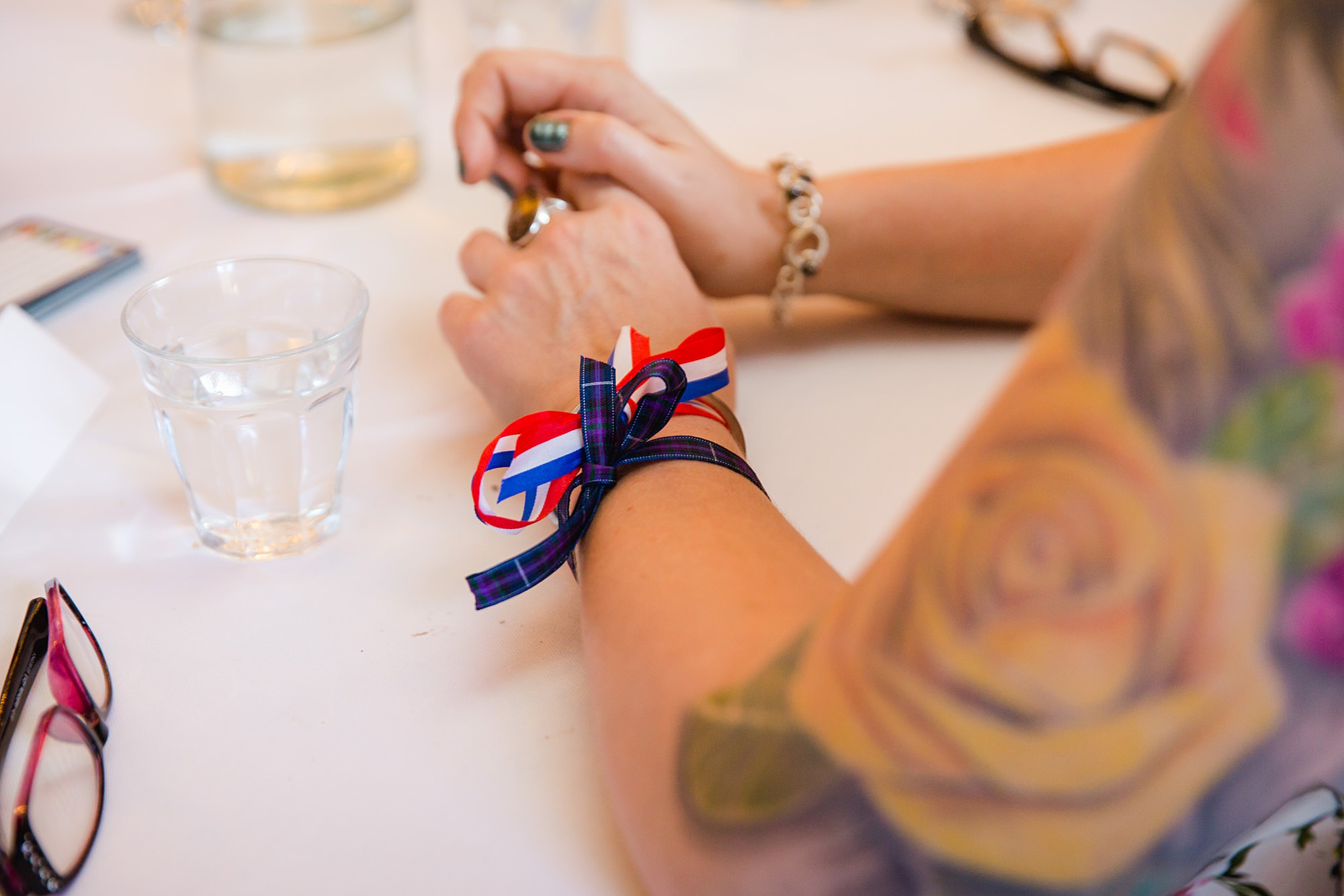 Clapton Country Club wedding photography flag ribbons on a wrist