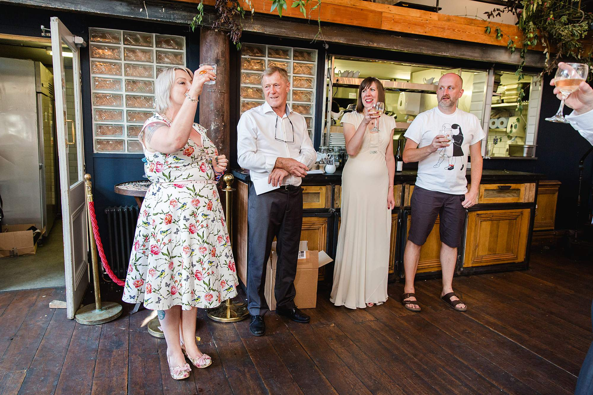 Clapton Country Club wedding photography guest makes a toast