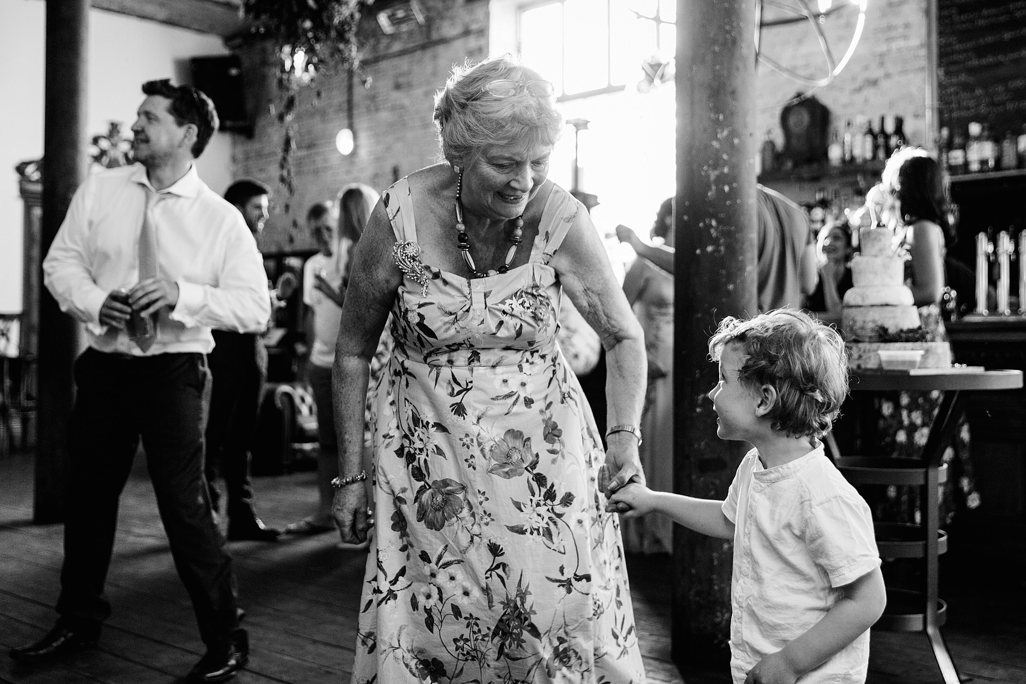 Clapton Country Club wedding photography guests dance together