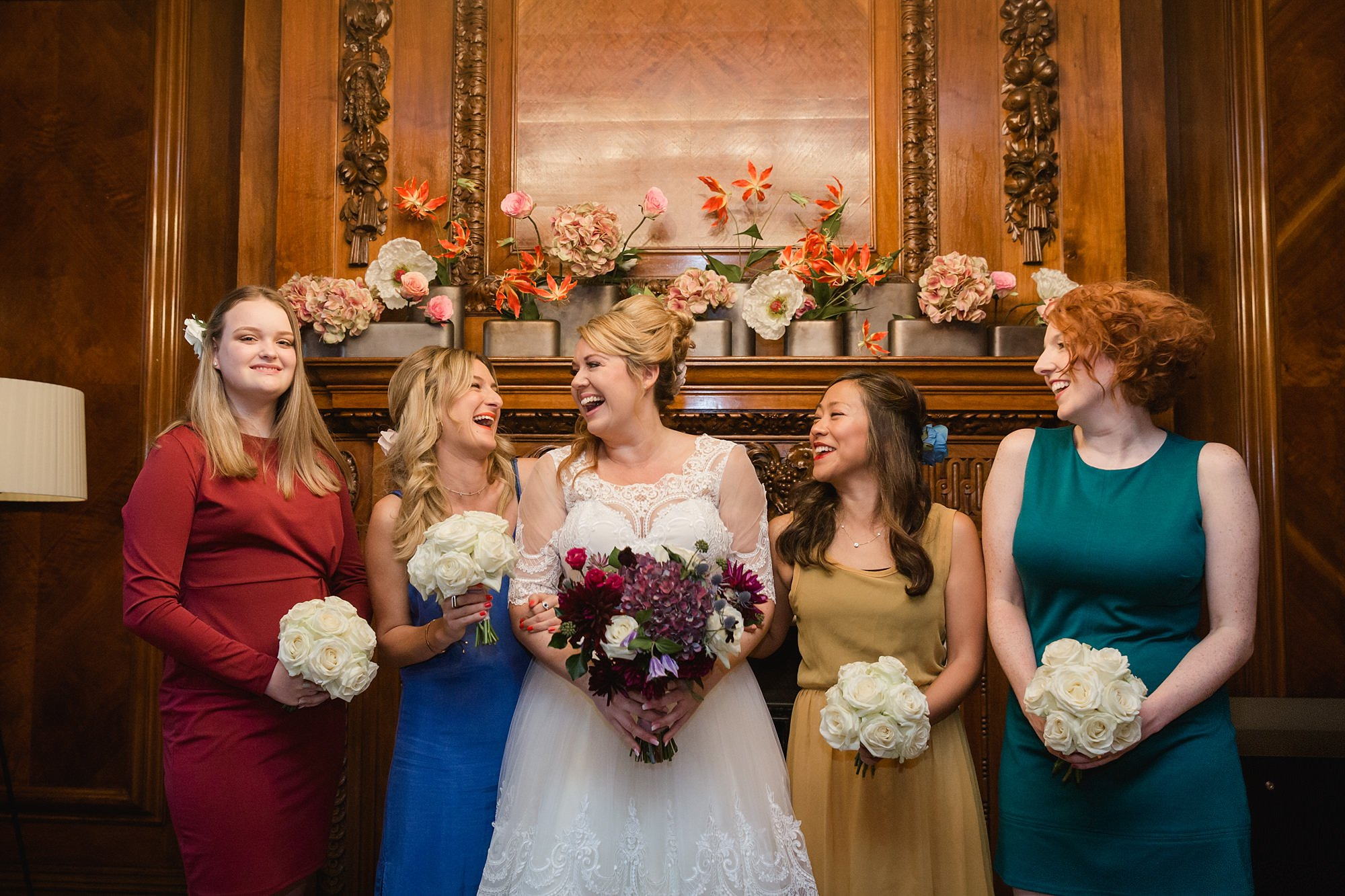 Old Marylebone Town Hall wedding photography bride and bridesmaids laughing