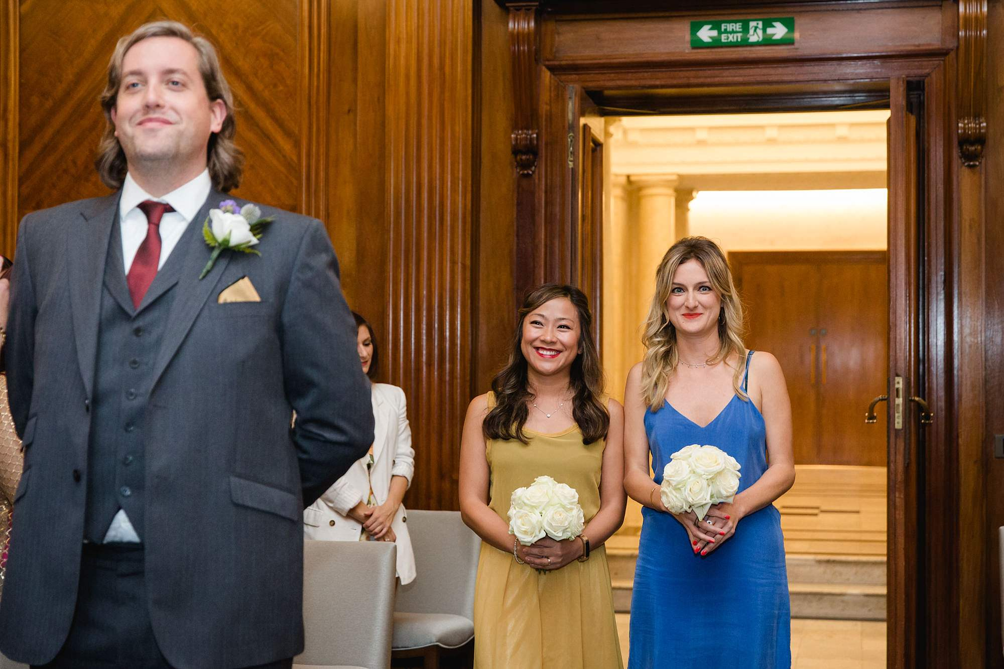 Old Marylebone Town Hall wedding photography bridesmaids enter ceremony