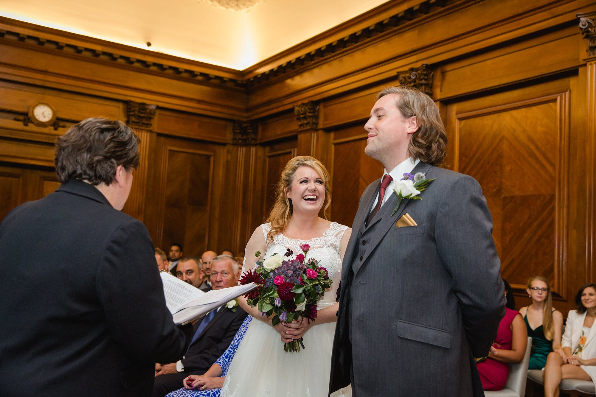 Old Marylebone Town Hall wedding photography bride laughs with groom