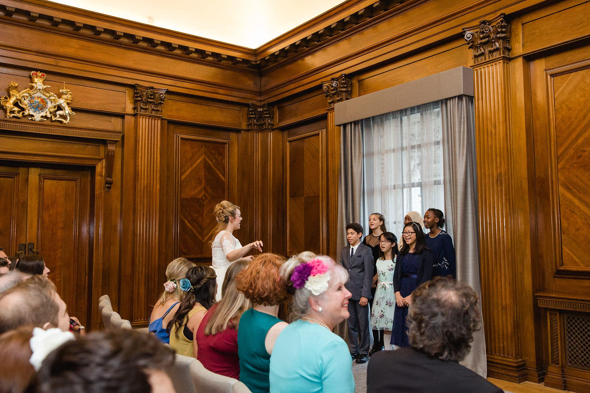 Old Marylebone Town Hall wedding photography bride conducts choir
