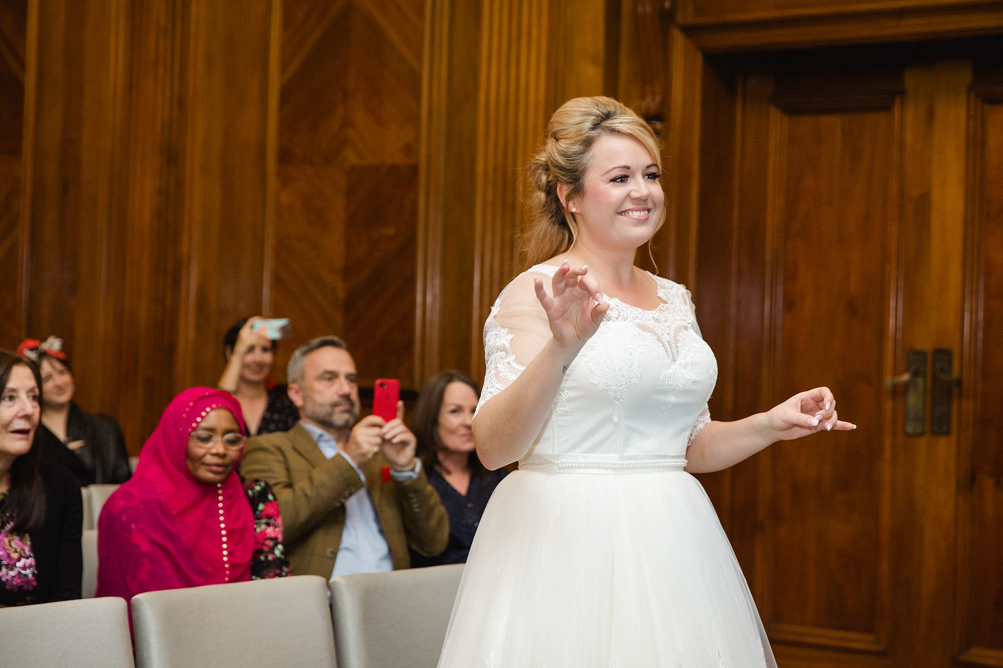 Old Marylebone Town Hall wedding photography portrait of bride conducting choir