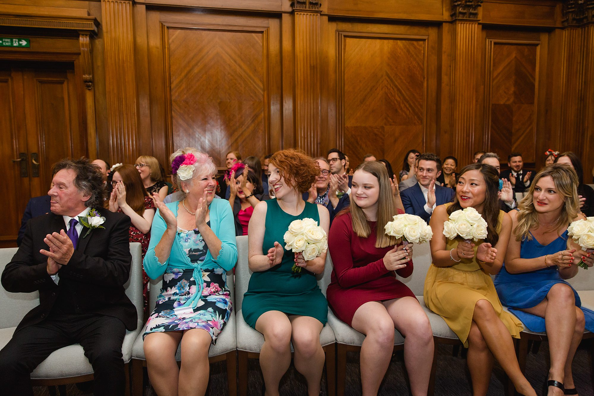 Old Marylebone Town Hall wedding photography guests clapping choir singers