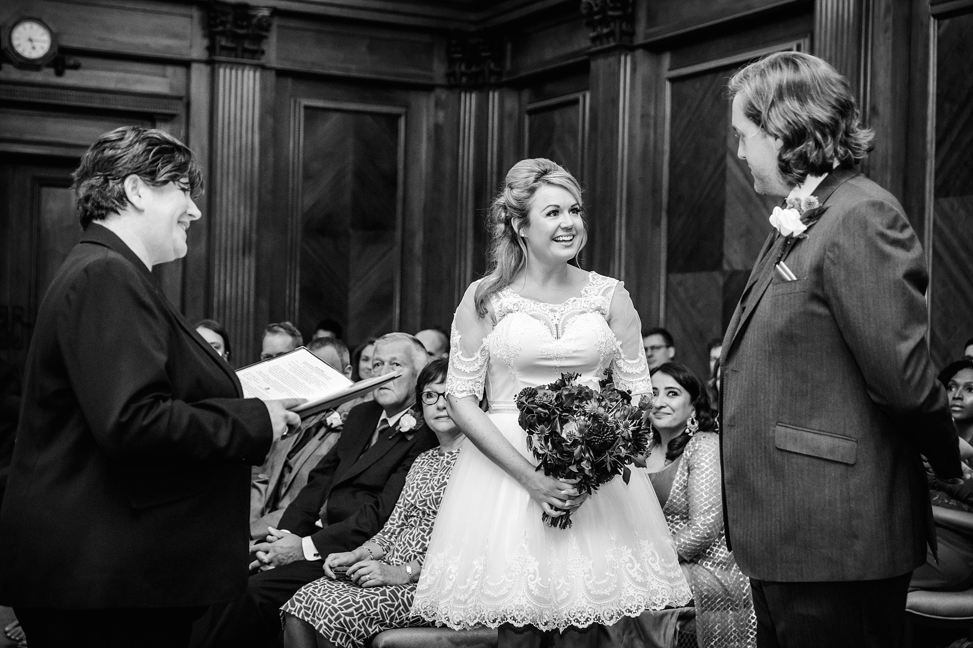 Old Marylebone Town Hall wedding photography bride and groom exchange vows