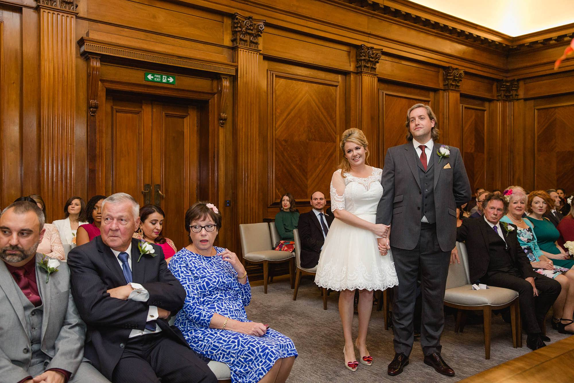 Old Marylebone Town Hall wedding photography couple watch singer perform