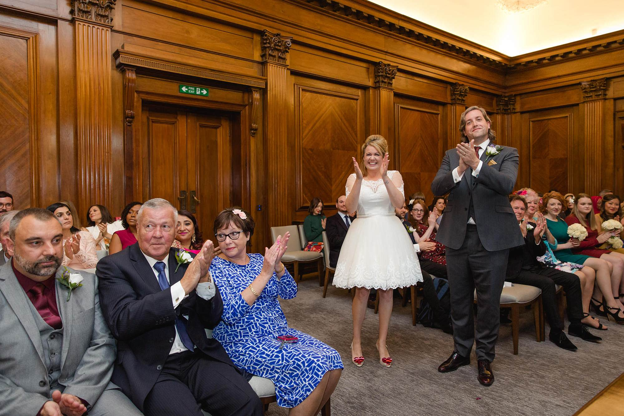 Old Marylebone Town Hall wedding photography bride and groom clap singer