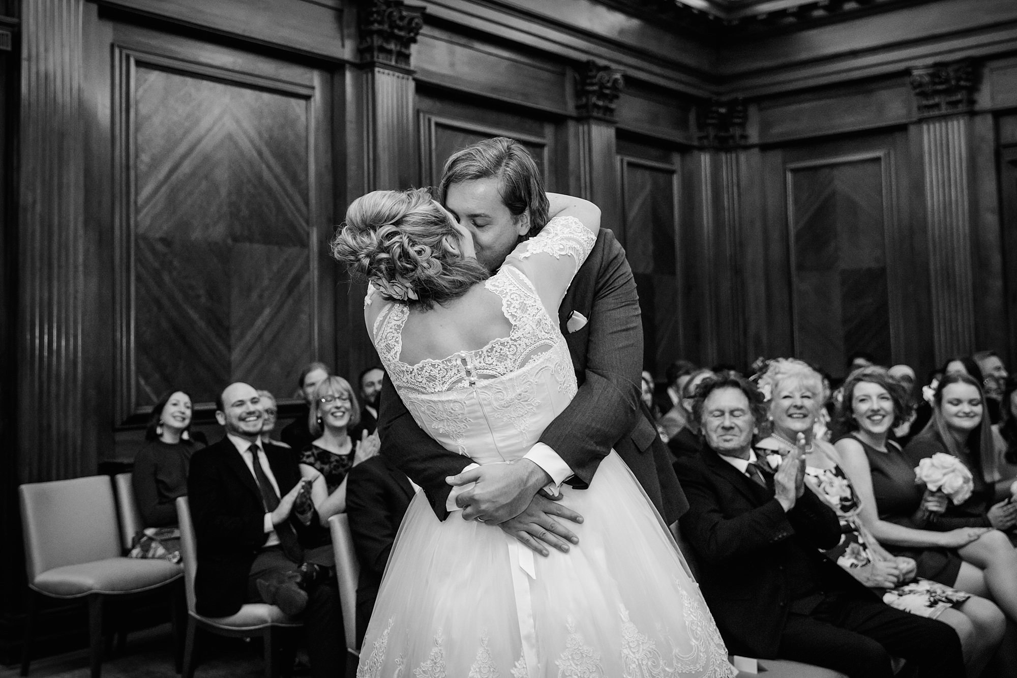 Old Marylebone Town Hall wedding photography bride and groom's first kiss