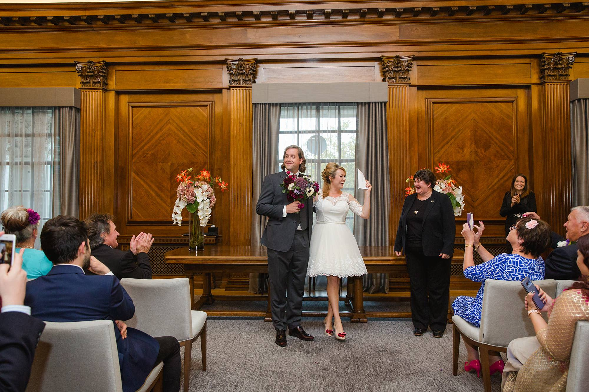 Old Marylebone Town Hall wedding photography bride and groom receive certificate