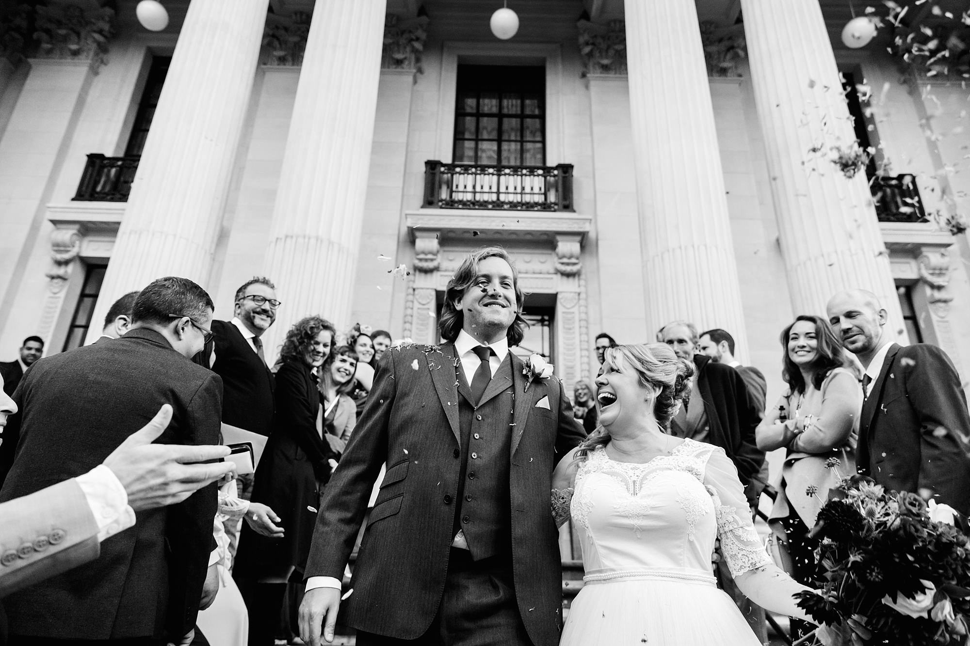 Old Marylebone Town Hall wedding photography couple in confetti