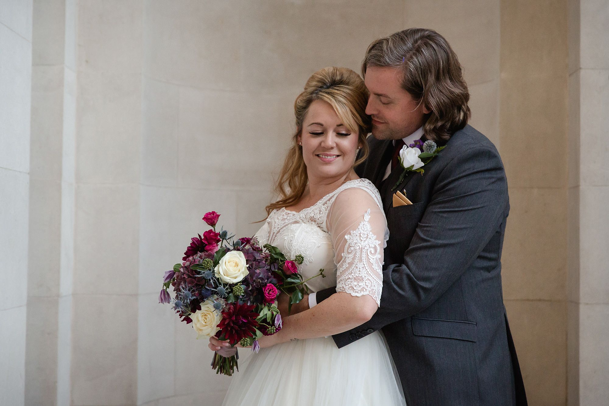 Old Marylebone Town Hall wedding photography groom cuddles bride