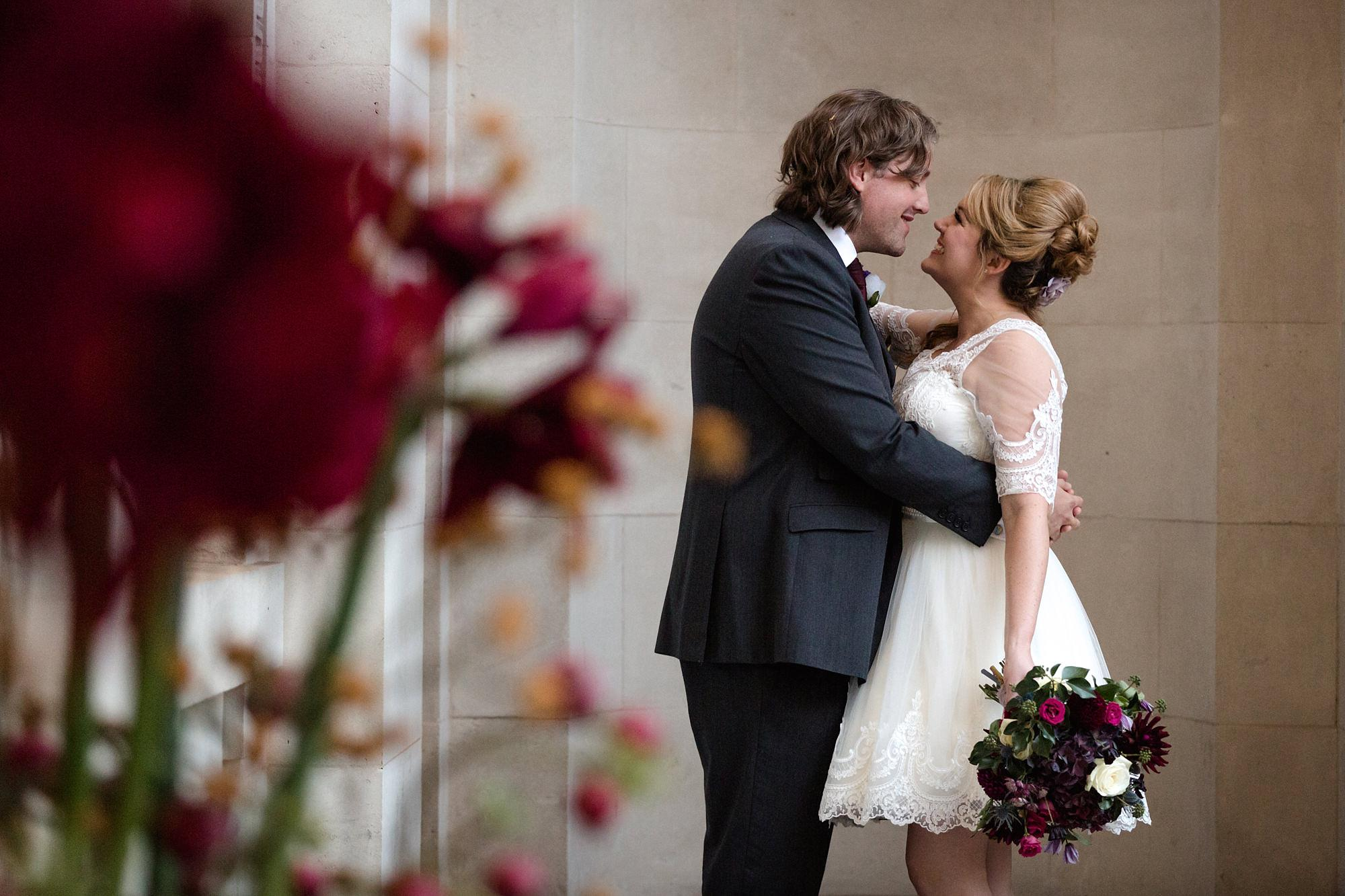 Old Marylebone Town Hall wedding photography bride and groom with flowers