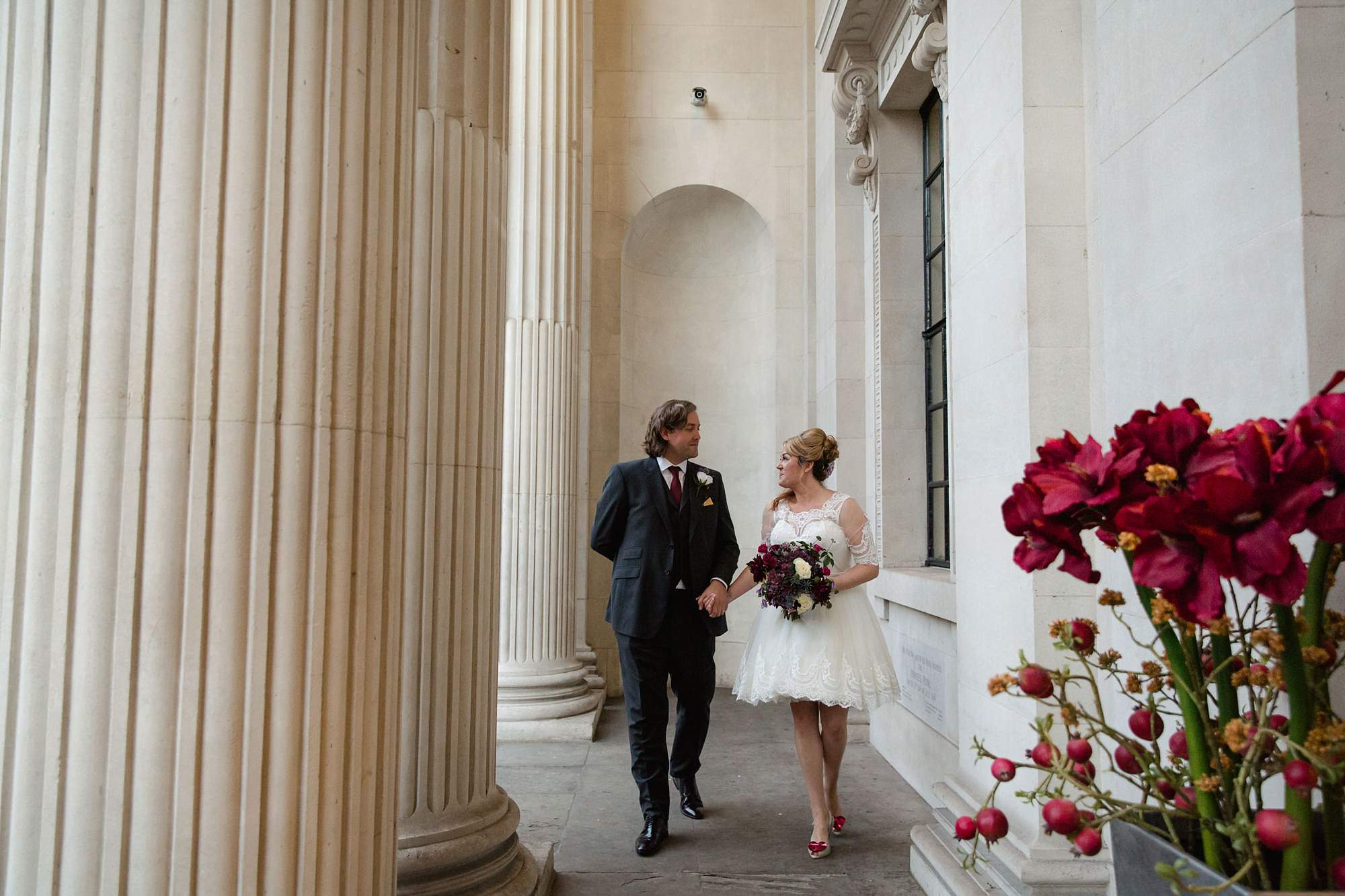 Old Marylebone Town Hall wedding photography bride and groom walking together