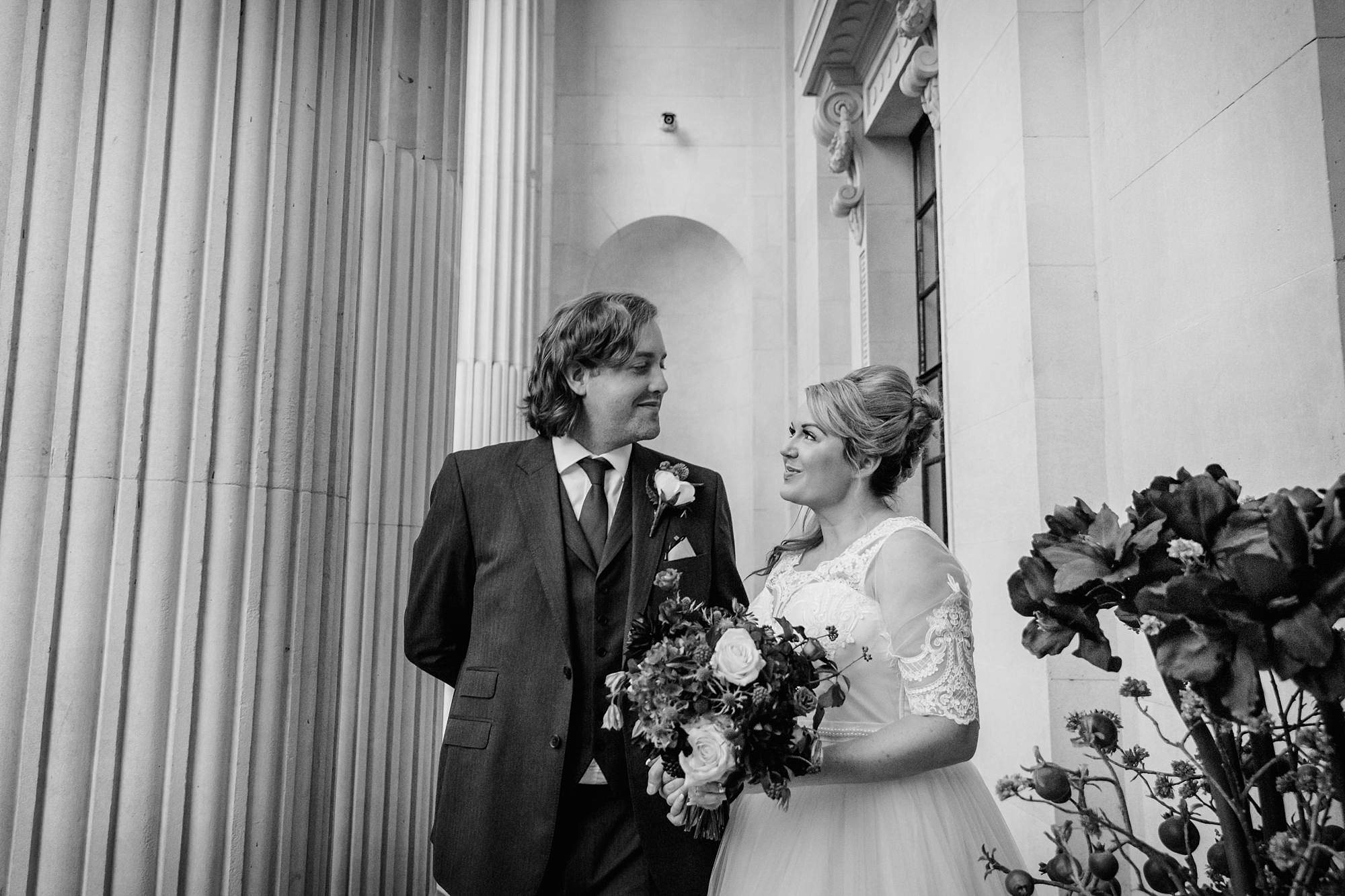 Old Marylebone Town Hall wedding photography bride and groom talking together