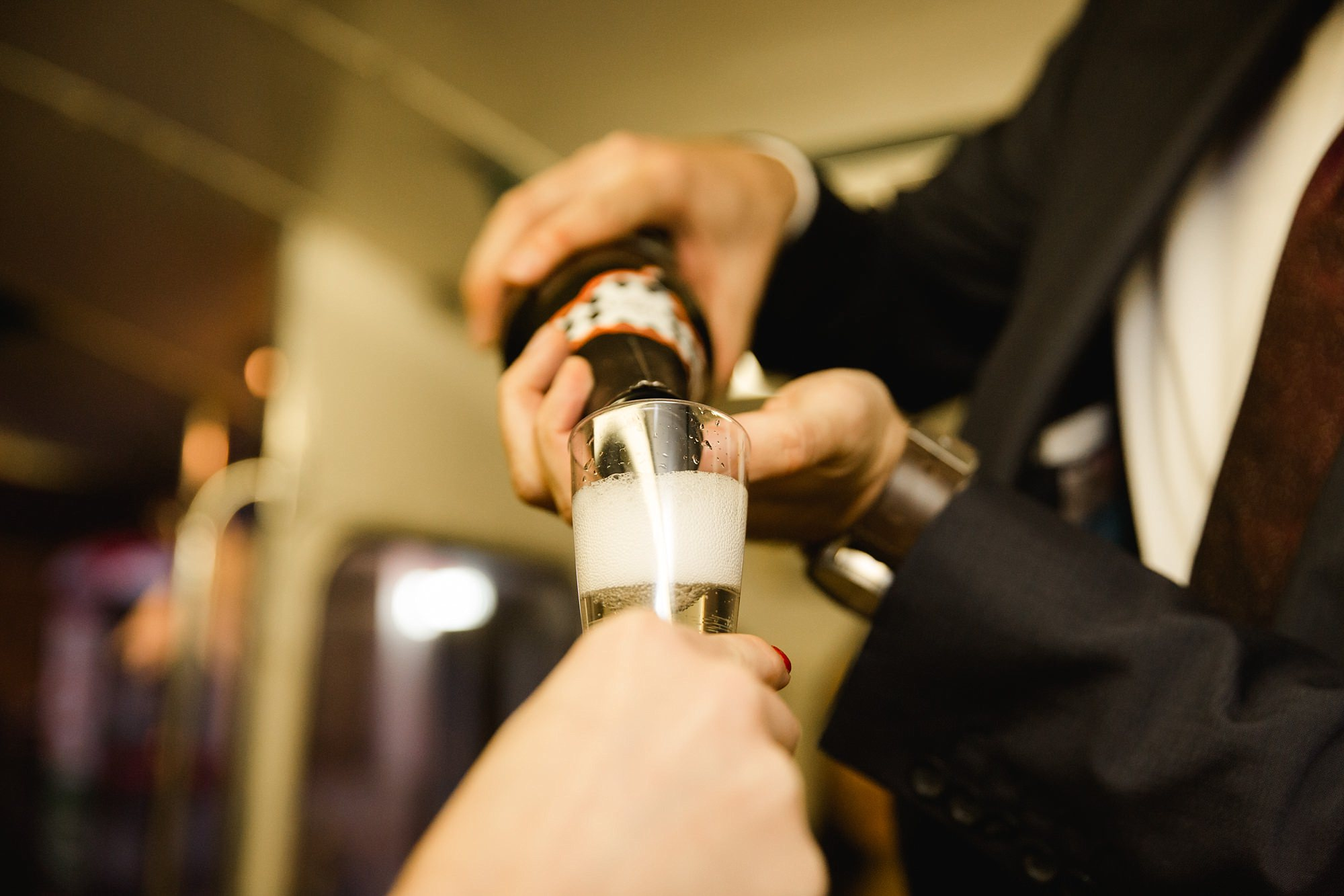 Old Marylebone Town Hall wedding photography hand pouring champagne