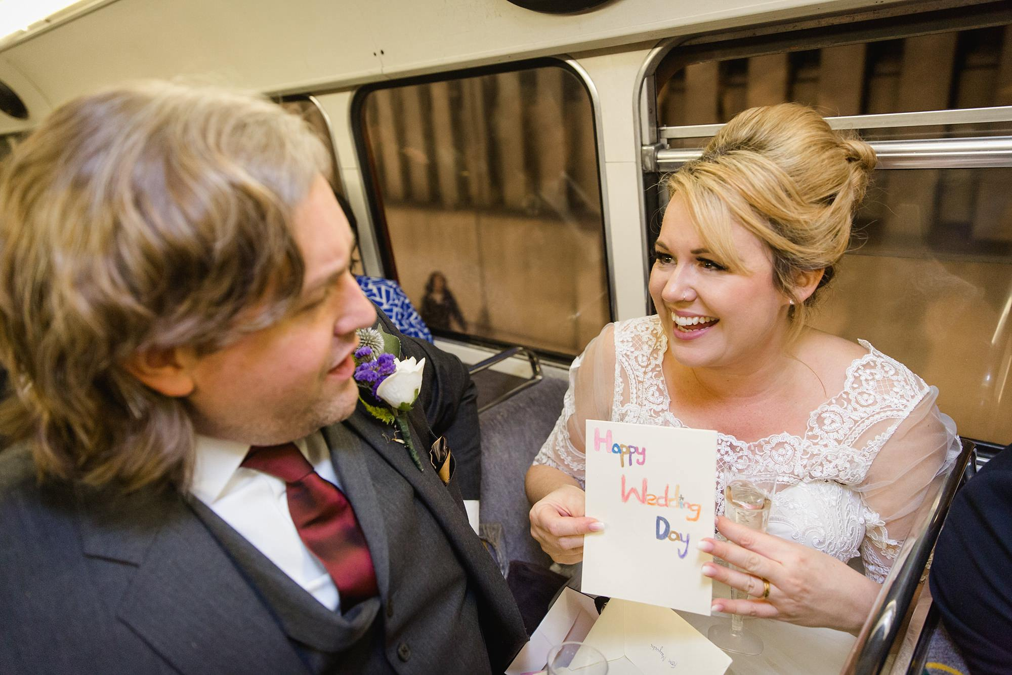 Old Marylebone Town Hall wedding photography bride and groom open wedding card