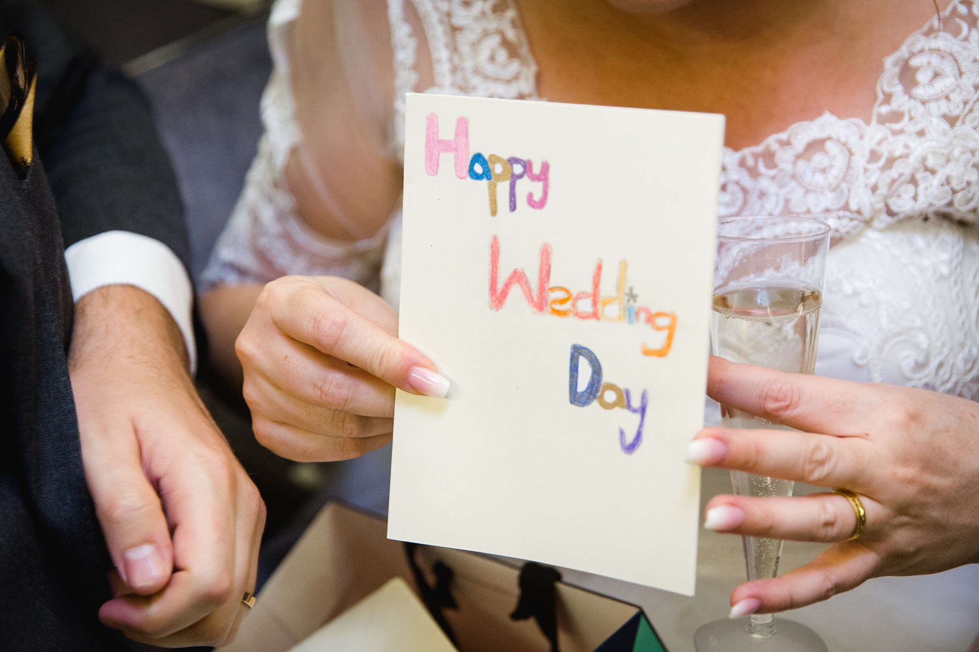 Old Marylebone Town Hall wedding photography bride sows off wedding card