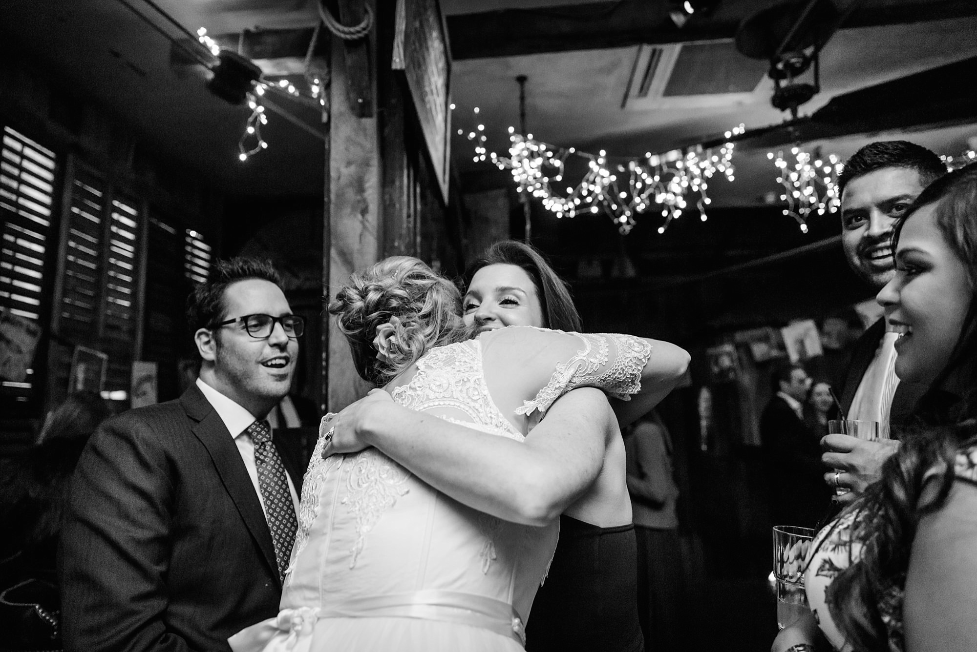 Old Marylebone Town Hall wedding photography guest hugs bride