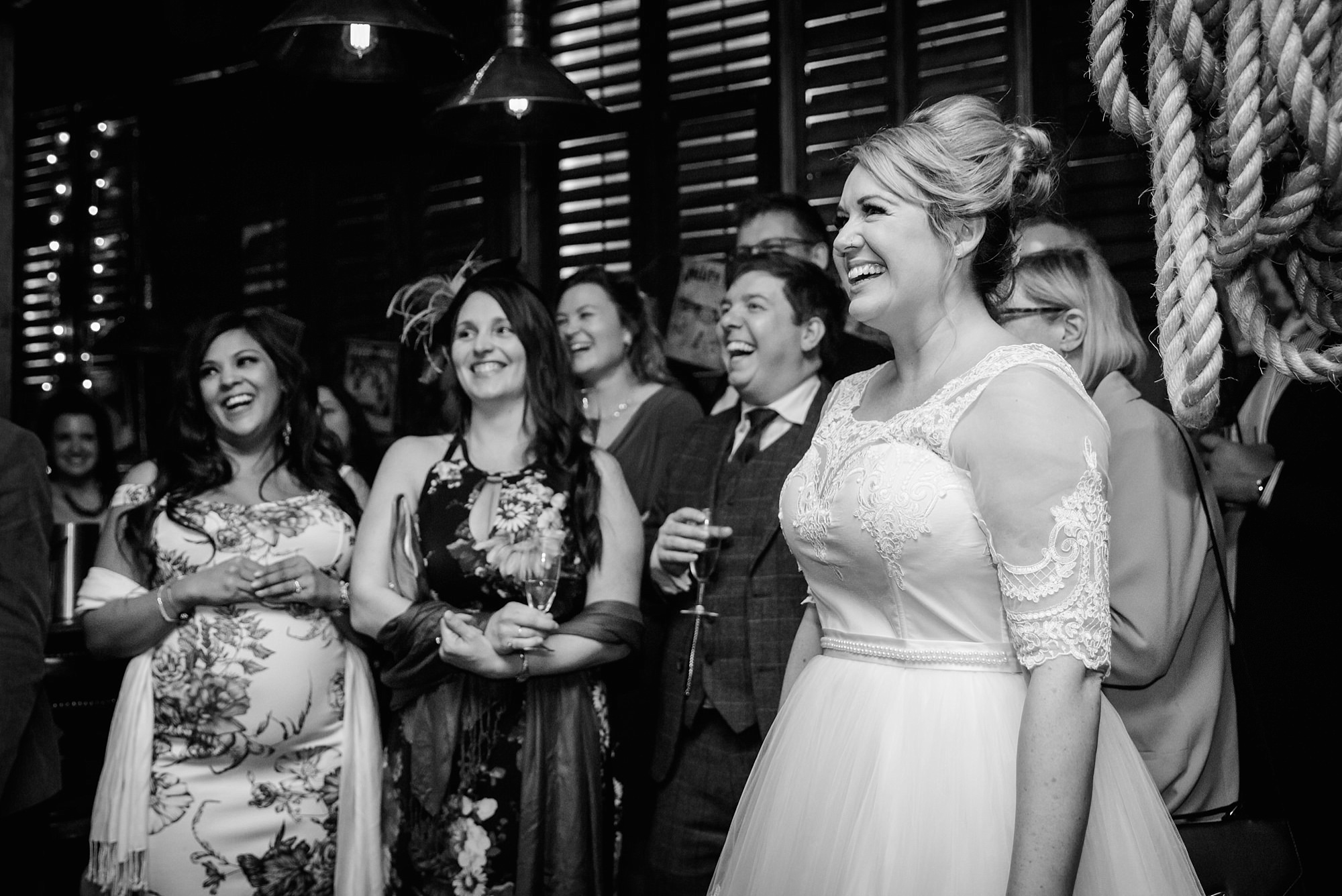 Old Marylebone Town Hall wedding photography bride laughing at speeches