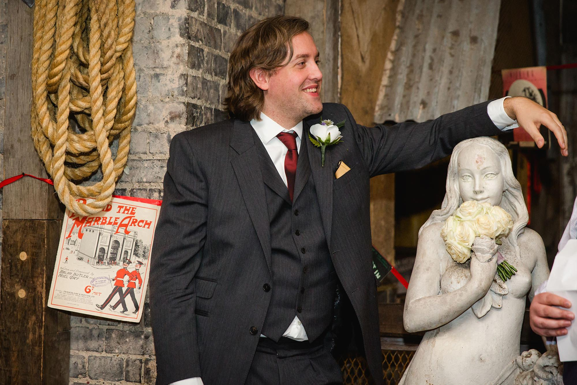 Old Marylebone Town Hall wedding photography groom laughs at speechest