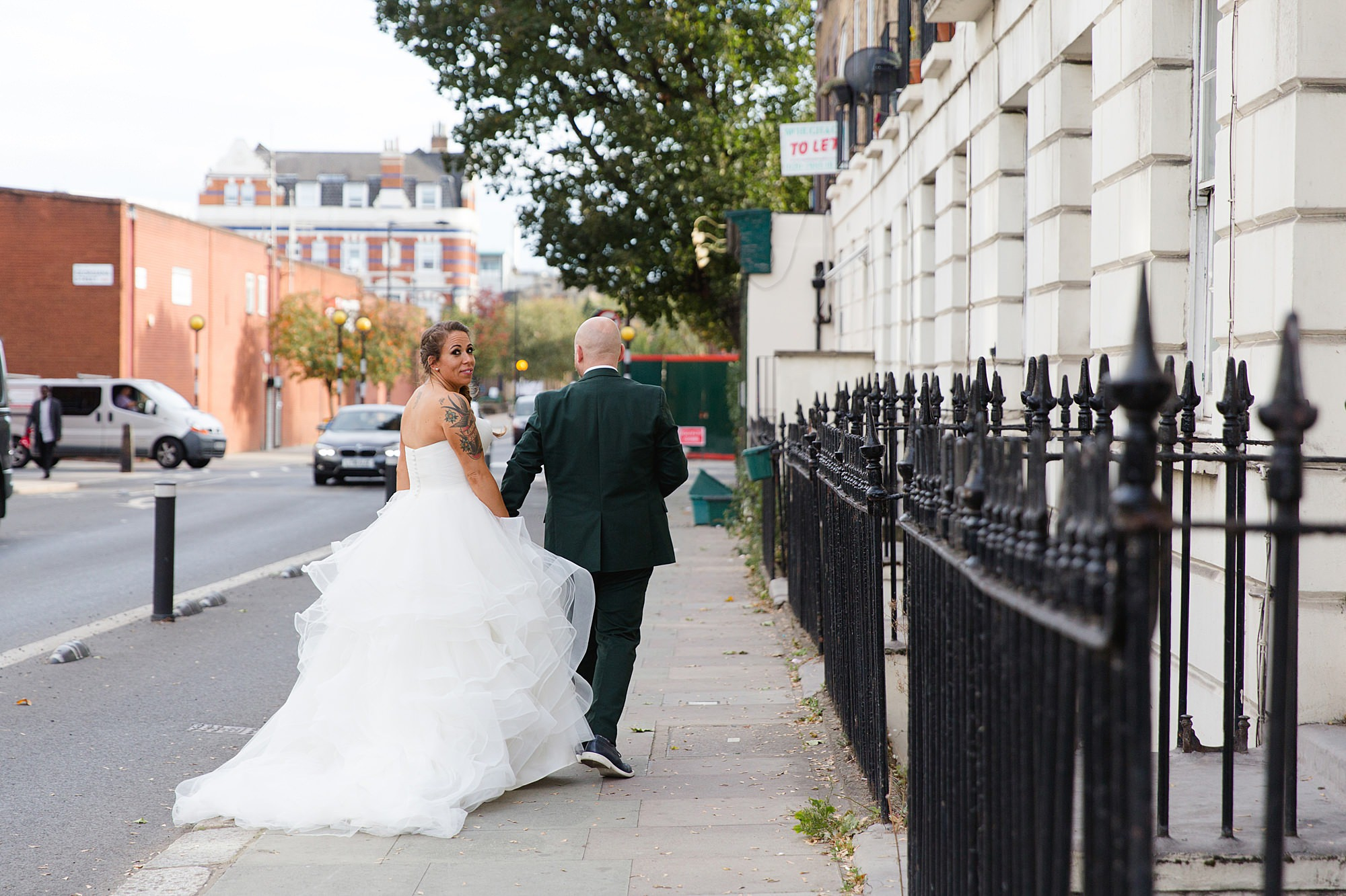 Prince albert camden wedding bride and groom walking on path