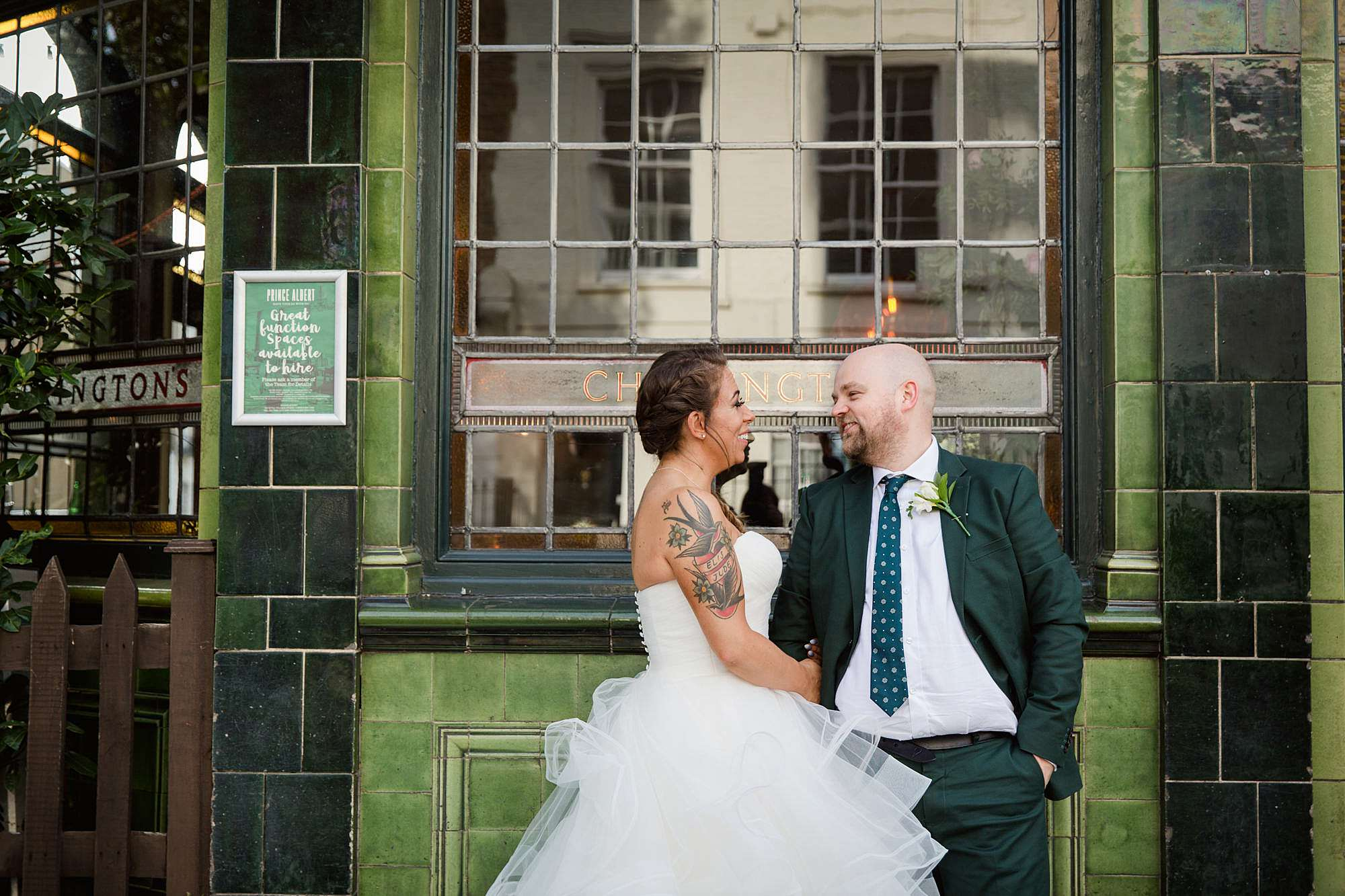 Prince albert camden wedding bride and groom chat outside pub