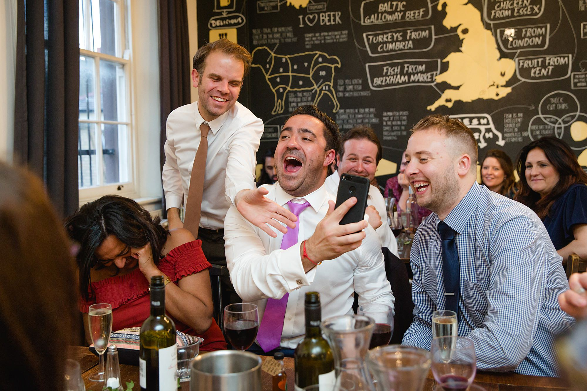 Prince albert camden wedding guests laughing at selfies