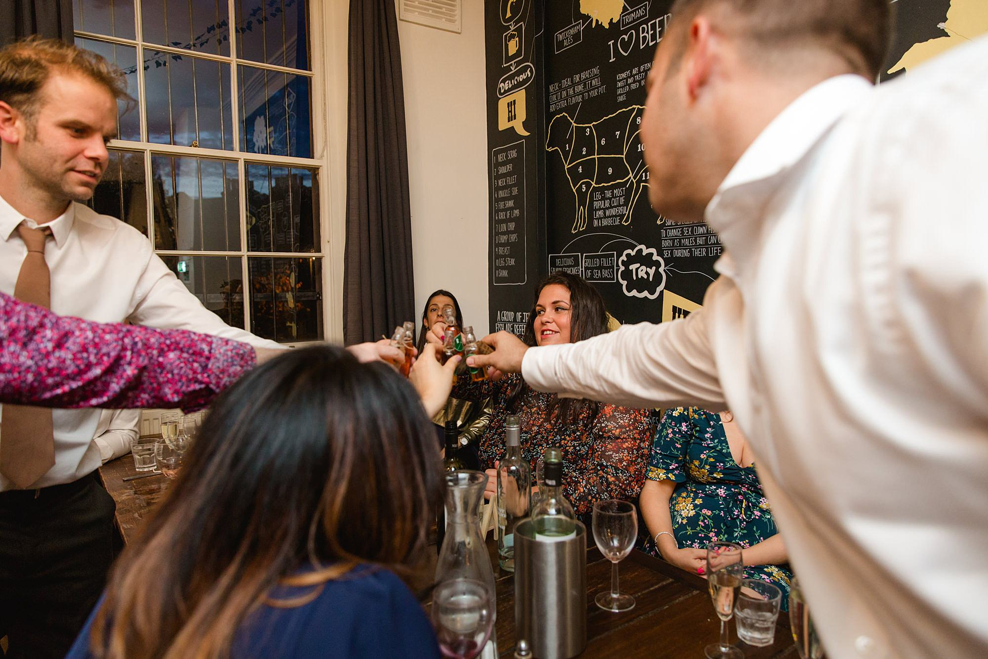 Prince albert camden wedding guests toast with shots