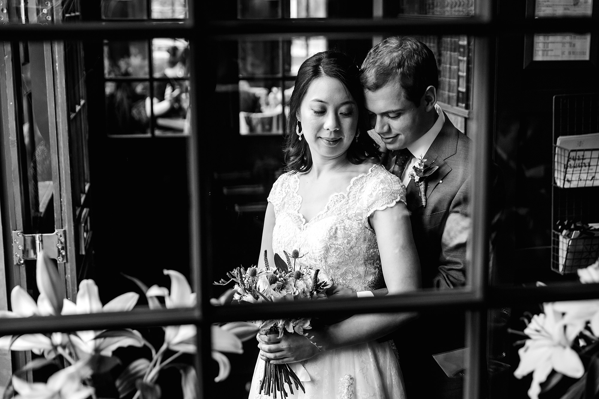 Wandsworth pub wedding bride and groom viewed through window pane