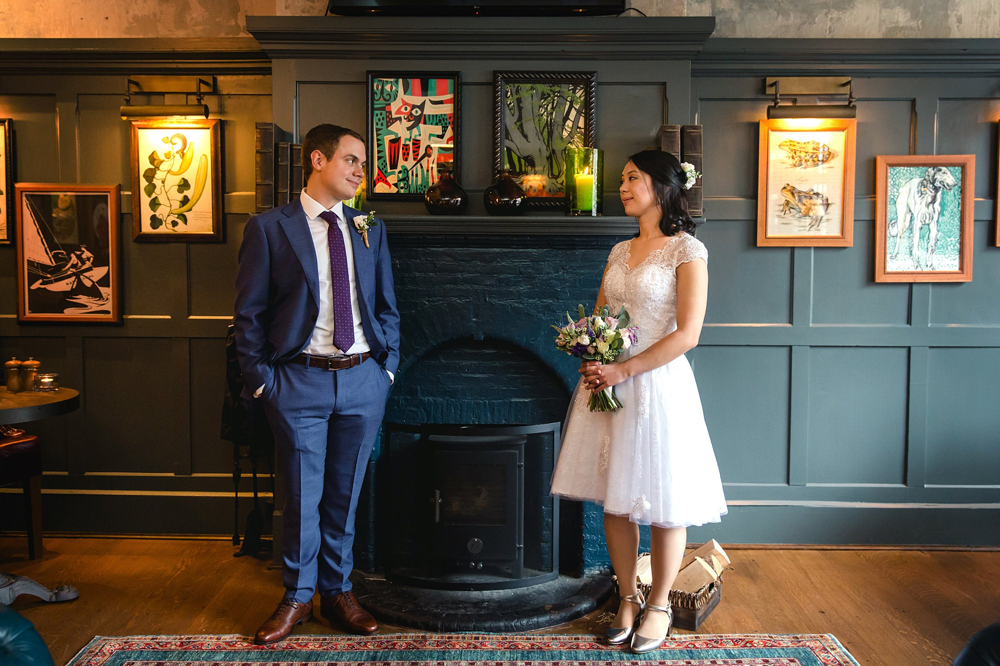 Wandsworth pub wedding couple by fireplace