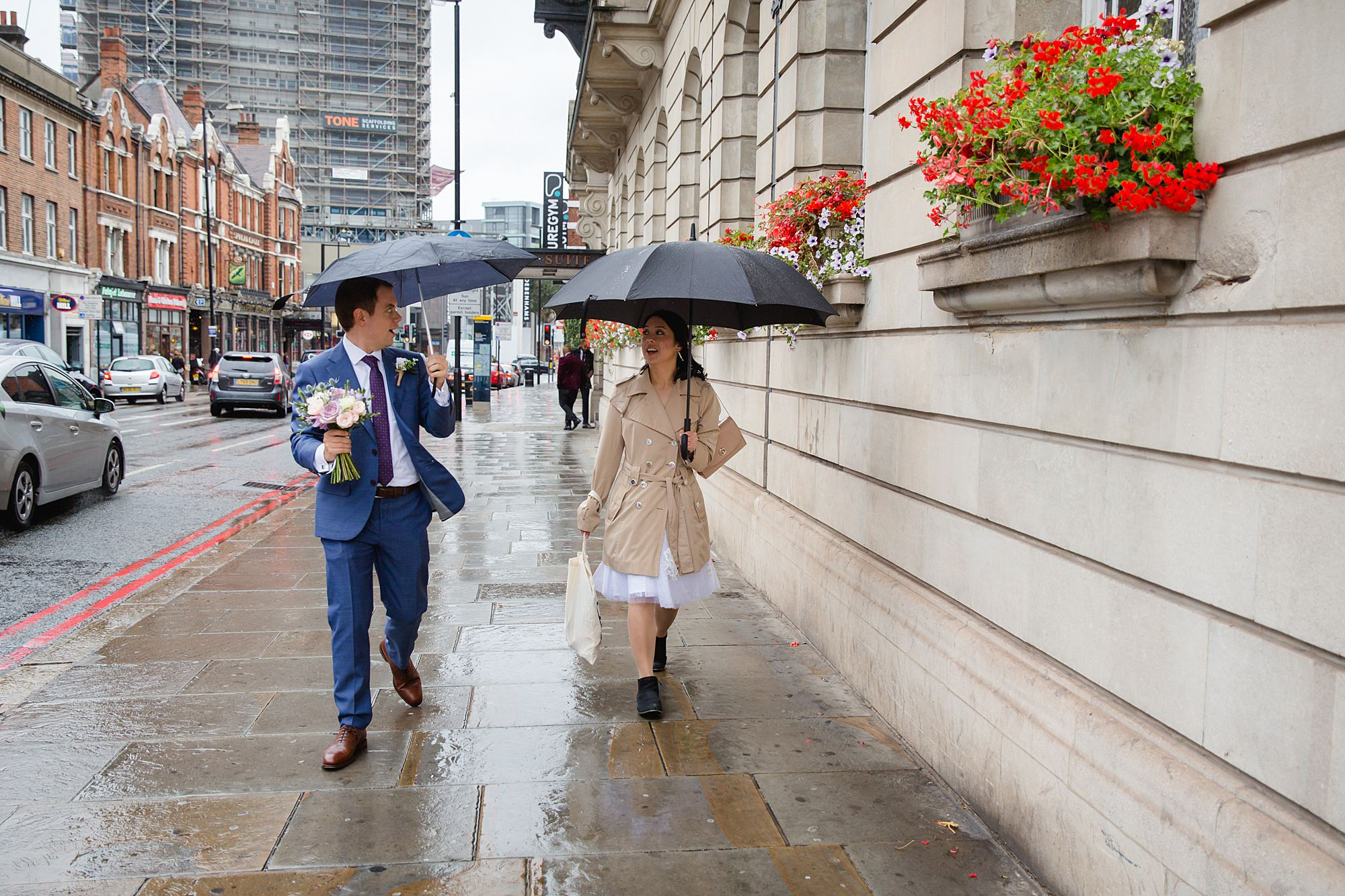 Wandsworth pub wedding bride and groom walking in the rain