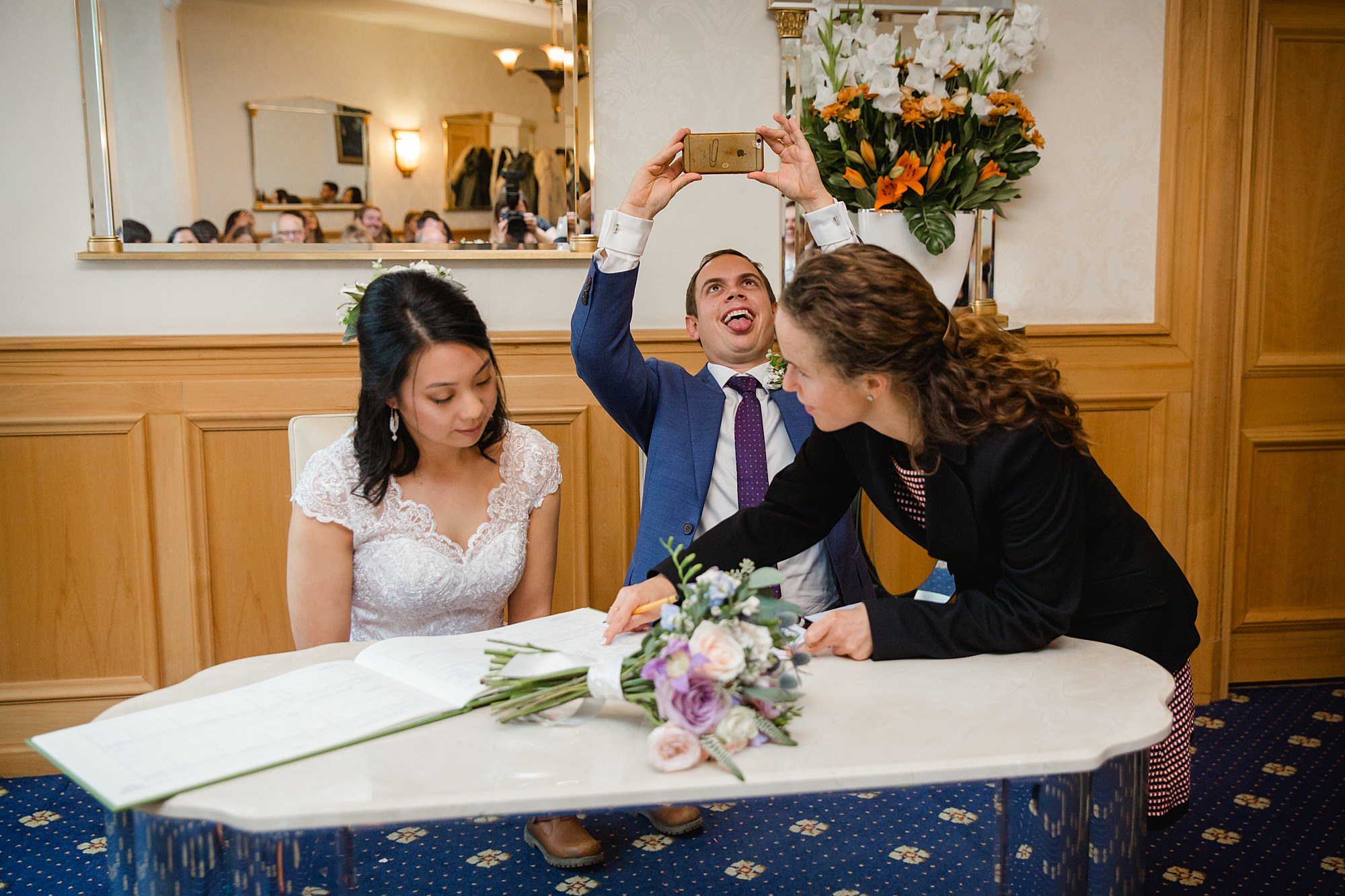 Wandsworth pub wedding groom takes selfie with register