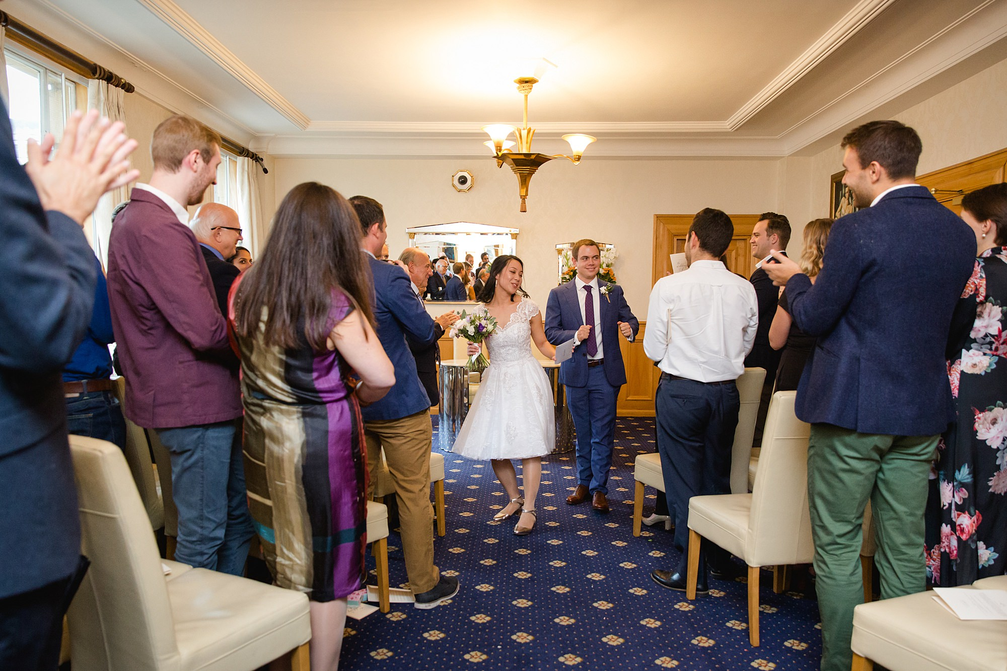 Wandsworth pub wedding bride and groom dance back down aisle