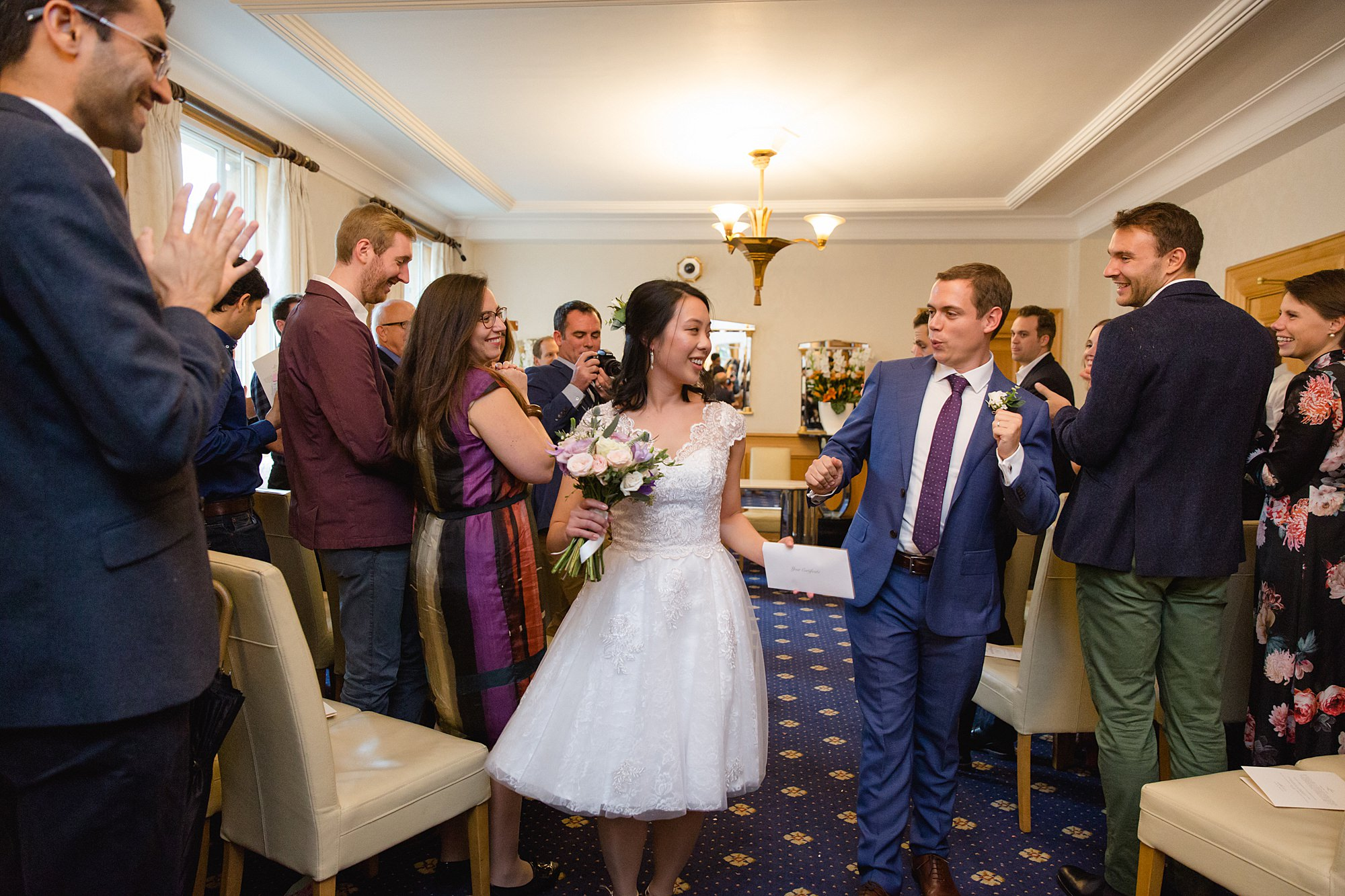 Wandsworth pub wedding bride and groom dance together after wedding ceremony at wandsworth town hal